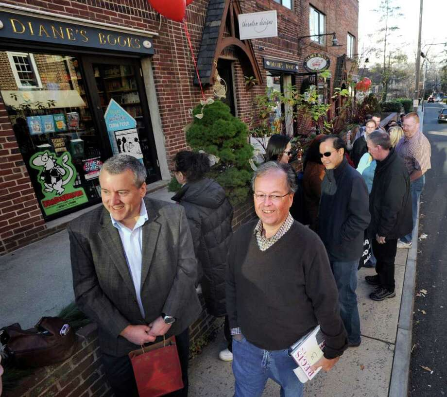 "At left, Steve Schroeder, of Redding, Pa., and Greenwich resident Frank D'Angelo, right, wait in line to meet Greenwich resident Regis Philbin during a book-signing by Philbin at Diane's Books in Greenwich, Saturday afternoon, Dec. 3, 2011. Philbin was at the store to promote his new memoir, ""How I Got This Way."" Photo: Bob Luckey / Greenwich Time"