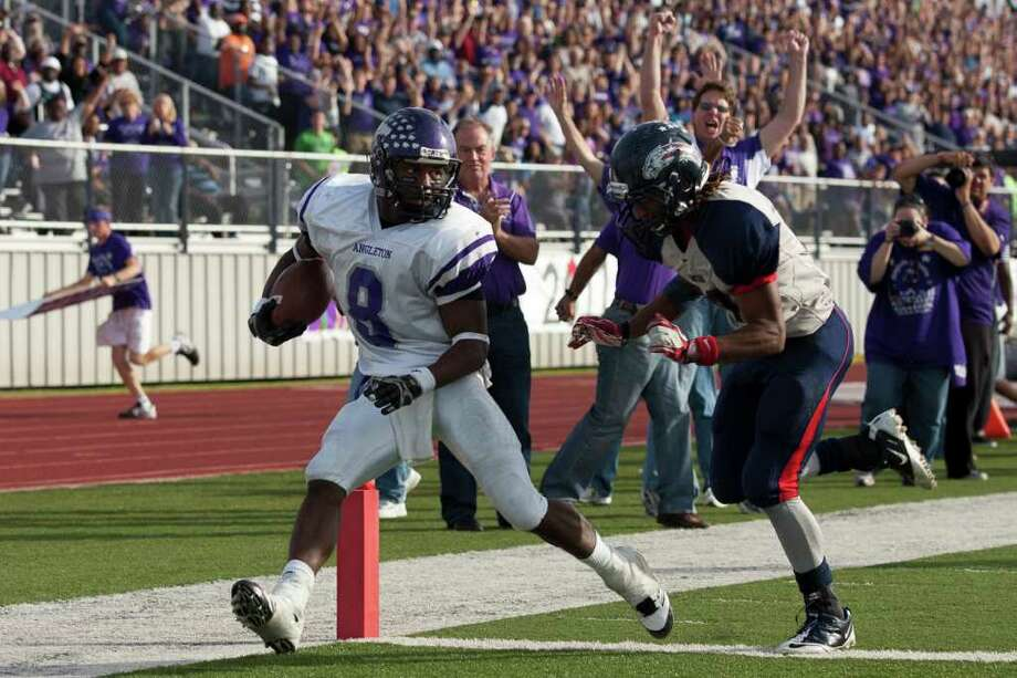 Wildcat tailback Ryan Jacson rushes for a touchdown as Angleton and Dawson face off during the second half in the Class 4A Div. I Region III championship Saturday afternoon December 3, 2011 at Pearland Stadium. The Angleton Wildcats could not hold off the Eagles in a 27-23 loss. 