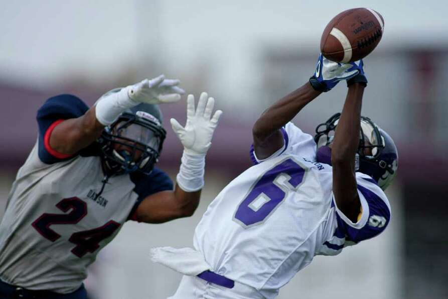 Wildcat wide receiver Kenric Dudley (6) barely misses a reception as Angleton and Dawson face off du