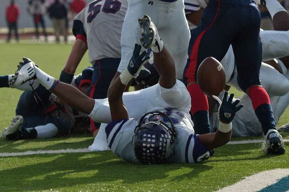 Wildcat fullback Josh West (23) fumbles in the end zone while trying for a two-point conversion in the second half as Angleton and Dawson face off in the Class 4A Div. I Region III championship Saturday afternoon December 3, 2011 at Pearland Stadium. Dawson's 27-23 win will take them to the Alimo Dome next week.