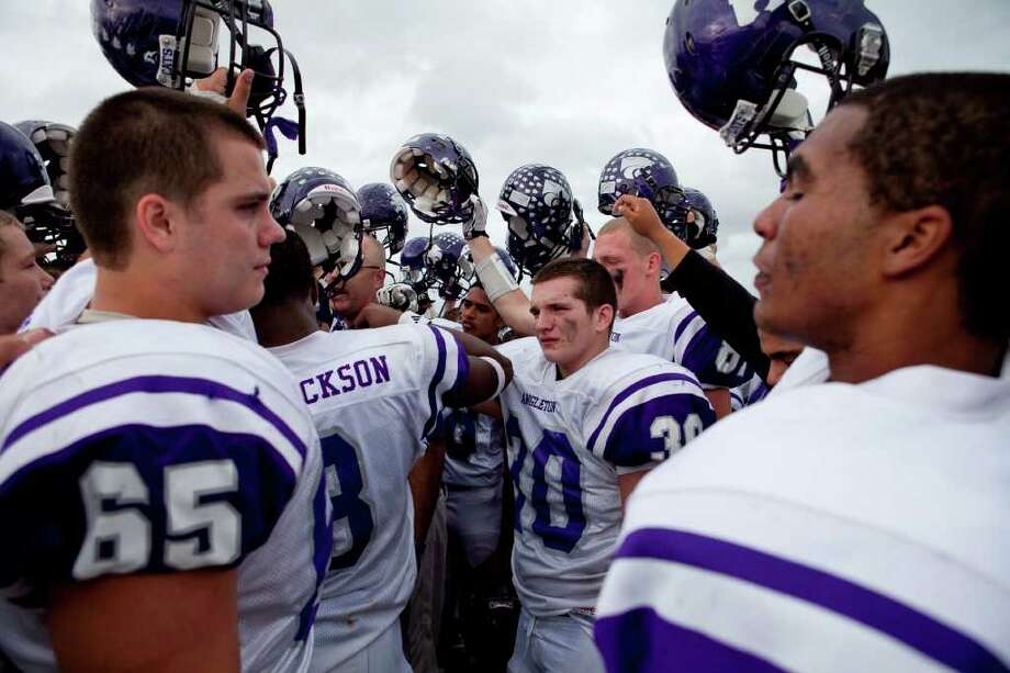 The Angleton Wildcast gather after loosing to  Dawson 27-23 in the Class 4A Div. I Region III championship Saturday afternoon December 3, 2011 at Pearland Stadium.