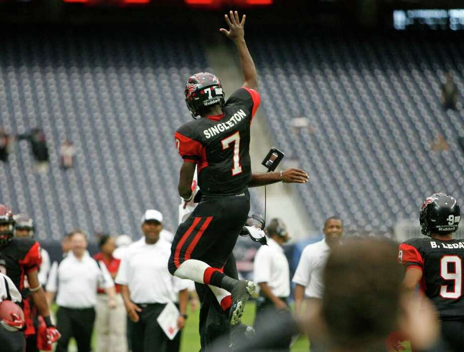 Port Arthur Memorial's quarterback Terrence Singleton jumps into the air after running the ball to score a touchdown against La Porte during the third quarter of District 21-5A Regional Finals high school football playoff game at Reliant Stadium Saturday, Dec. 3, 2011, in Houston. Photo: James Nielsen, Houston Chronicle / © 2011 Houston Chronicle