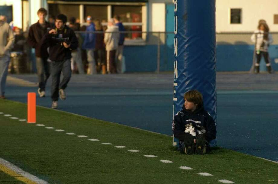 Non-game action in the Newtown vs. Staples class LL semifinal football game at Bunnell High School in Stratford on Saturday, Dec. 3, 2011. Staples won 44-20. Photo: Jason Rearick / The News-Times