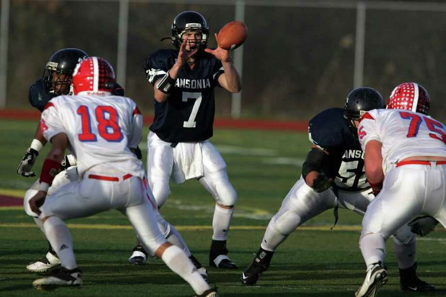 Ansonia High School's quarterback # 7 Elliot Chudwick eyes the football during first half action against Berlin High School during  CIAC semifinal on Saturday Nov. 3, 2011 at Sheehan High School in Wallingford, Conn. Photo: Mike Ross / Connecticut Post Freelance