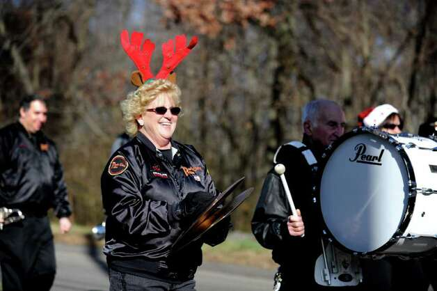 Cymbal player Dee Henry, of Hamden, marches with the Park City Pride Alumni Drum and Bugle Corps during the PAL Christmas Village parade in Trumbull Saturday, Dec. 3, 2011. Photo: Autumn Driscoll / Connecticut Post