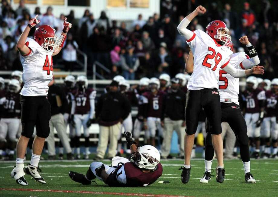 New Canaan celebrates after taking the lead Saturday, Dec. 3, 2011 in the final seconds of the Class L seminfinal game against Windsor at East Haven High School in East Haven, Conn. Photo: Autumn Driscoll / Connecticut Post