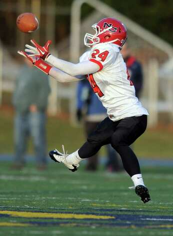 New Canaan's Patrick Newton catches a pass Saturday, Dec. 3, 2011 during the Class L seminfinal game against Windsor at East Haven High School in East Haven, Conn. Photo: Autumn Driscoll / Connecticut Post