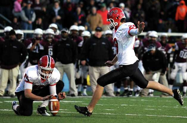 New Canaan's Collin Shapiro kicks a field goal Saturday, Dec. 3, 2011 in the final seconds of the Class L seminfinal game against Windsor at East Haven High School in East Haven, Conn. Photo: Autumn Driscoll / Connecticut Post