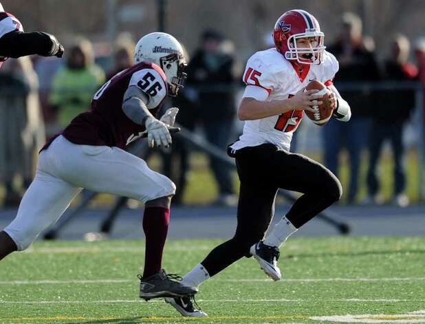 New Canaan's Matthew Milano carries the ball as Windsor's Ben Compton tries to take him Saturday, Dec. 3, 2011 during the Class L seminfinal game at East Haven High School in East Haven, Conn. Photo: Autumn Driscoll / Connecticut Post