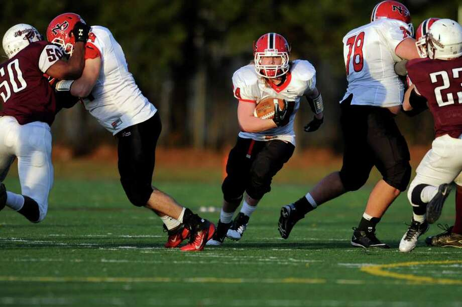 New Canaan's Robert Distler carries the ball Saturday, Dec. 3, 2011 during the Class L seminfinal game against Windsor at East Haven High School in East Haven, Conn. Photo: Autumn Driscoll / Connecticut Post