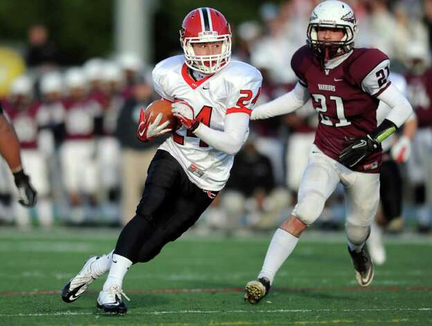 New Canaan's Patrick Newton carries the ball as Windsor's Brendan Gale tries to catch him Saturday, Dec. 3, 2011 during the Class L seminfinal game at East Haven High School in East Haven, Conn. Photo: Autumn Driscoll / Connecticut Post
