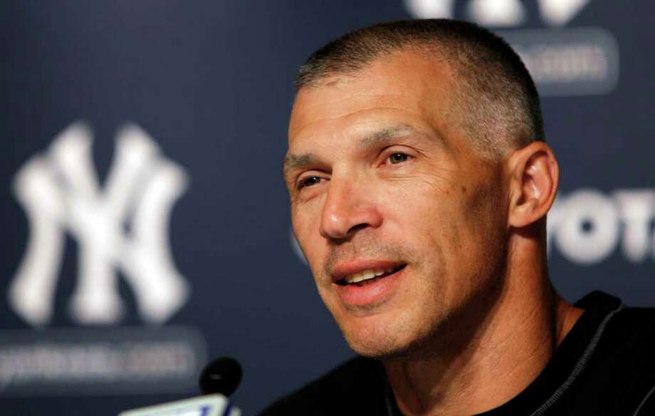 New York Yankees manager Joe Girardi speaks during a news conference at Yankee Stadium in March. Girardi and his wife were seen having dinner at Gabriele's Italian Steakhouse in Greenwich last week. (AP Photo/Frank Franklin II) Photo: Frank Franklin II, ST / AP