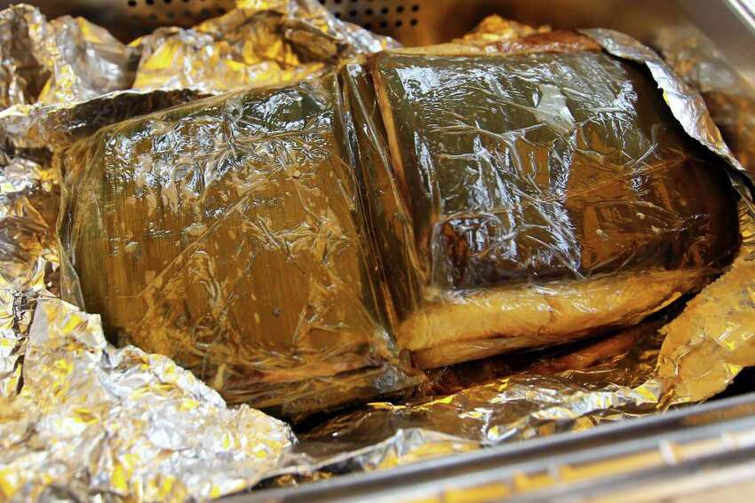 Banana leaf tamales with chicken and oaxaca style mole at the Tamahli booth during Tamales at Pearl, Saturday, December 3, 2011.