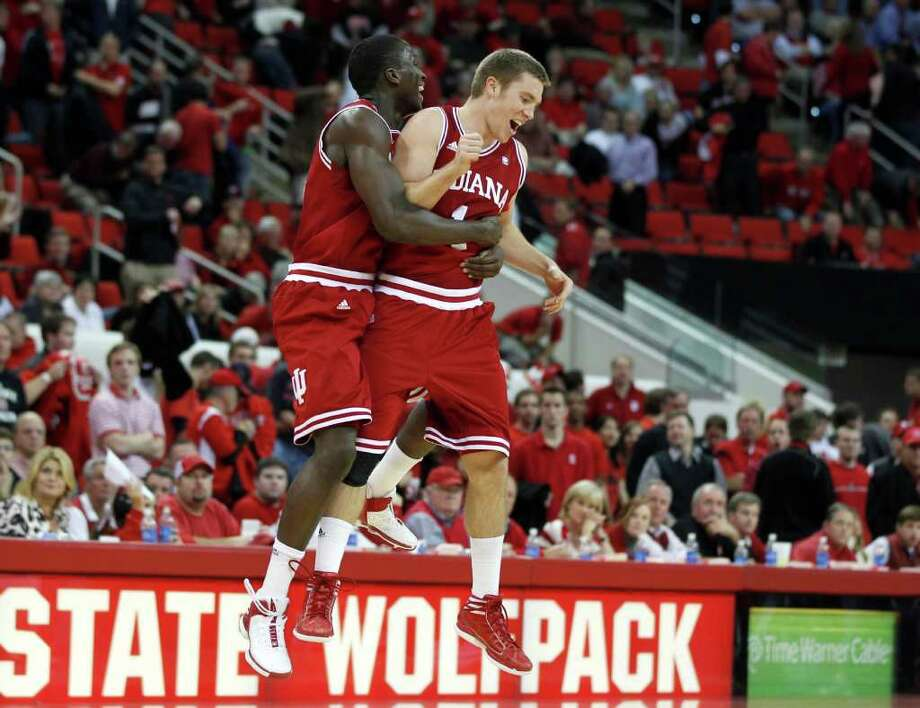 Indiana's Victor Oladipo (left) and Jordan Hulls celebrate their 86-75 victory over North Carolina State on Wednesday. The Hoosiers seek to end a three-year run of losing records. Photo: ETHAN HYMAN, ASSOCIATED PRESS