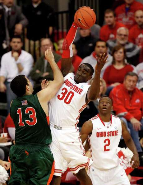 Ohio State's Evan Ravenel, filling in for injured star Jared Sullinger, fights for a rebound against UT-Pan Am. Photo: TERRY GILLIAM, ASSOCIATED PRESS