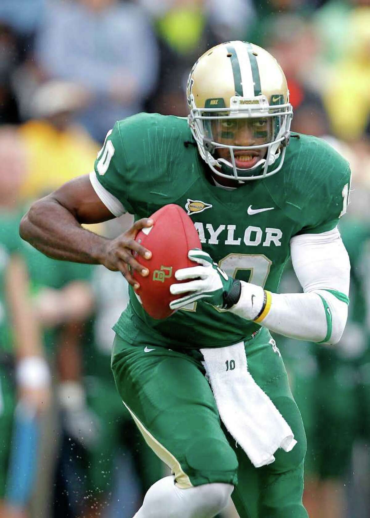 WACO, TX - DECEMBER 03: Robert Griffin III #10 of the Baylor Bears runs during a game against the Texas Longhorns at Floyd Casey Stadium on December 3, 2011 in Waco, Texas.