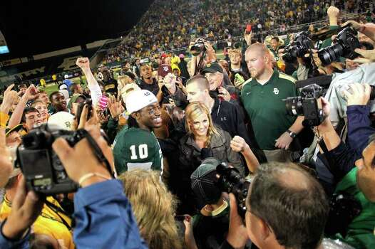 WACO, TX - DECEMBER 03: Robert Griffin III #10 of the Baylor Bears is interviewed after a game against the Texas Longhorns at Floyd Casey Stadium on December 3, 2011 in Waco, Texas. The Baylor Bears defeated the Texas Longhorns 48-24. Photo: Sarah Glenn, Getty / 2011 Getty Images