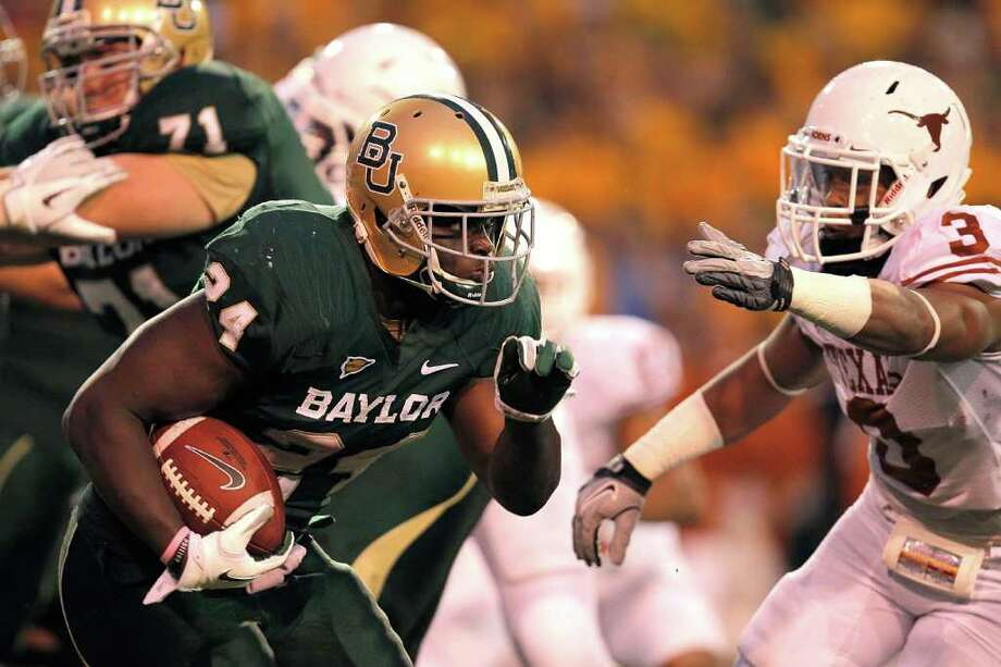 WACO, TX - DECEMBER 03:  Terrance Ganaway #24 of the Baylor Bears runs during a game against the Texas Longhorns at Floyd Casey Stadium on December 3, 2011 in Waco, Texas. The Baylor Bears defeated the Texas Longhorns 48-24. Photo: Sarah Glenn, Getty / 2011 Getty Images