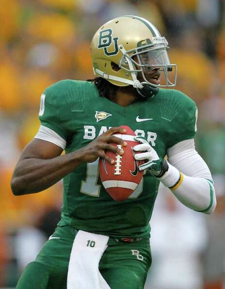 WACO, TX - DECEMBER 03:  Robert Griffin III #10 of the Baylor Bears looks to pass during a game agai