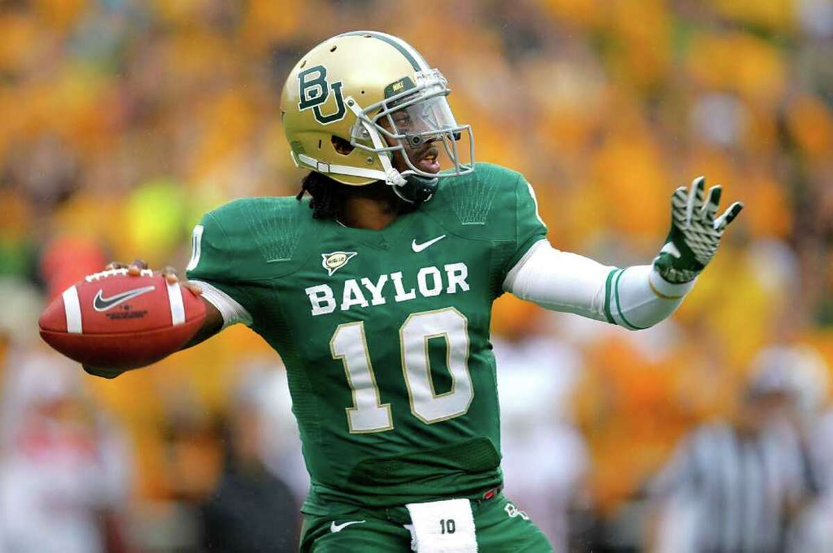 WACO, TX - DECEMBER 03: Robert Griffin III #10 of the Baylor Bears looks to pass during a game against the Texas Longhorns at Floyd Casey Stadium on December 3, 2011 in Waco, Texas.
