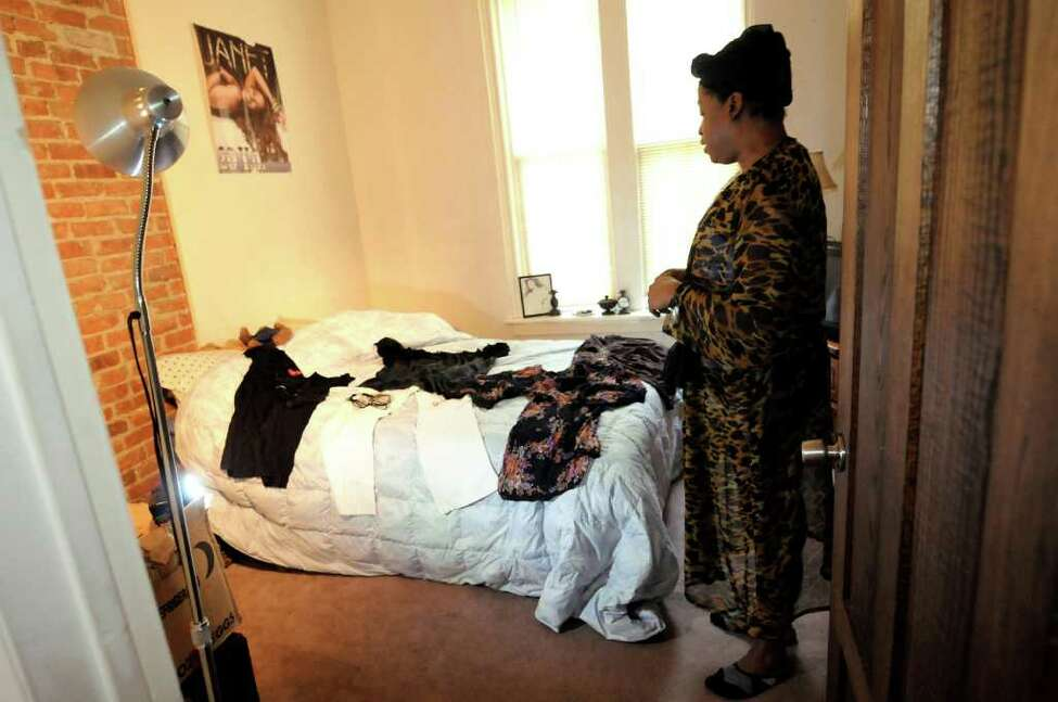 Kym Dorsey, a transgender woman, looks over the outfit she selected for the day on Monday, April 11, 2011, at her home in Albany, N.Y. (Cindy Schultz / Times Union)