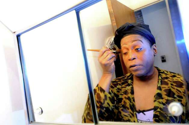 Kym Dorsey, a transgender woman, puts on her makeup on Monday, April 11, 2011, at her home in Albany, N.Y. (Cindy Schultz / Times Union) Photo: Cindy Schultz