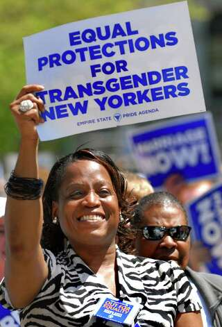Kym Dorsey holds a sign to support the Gender Expression Non-Discrimination Act during a Pride Agenda rally on Monday, May 9, 2011, at the Capitol in Albany, N.Y. (Cindy Schultz / Times Union) Photo: Cindy Schultz