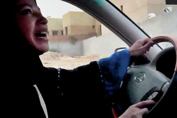 FILE - In this Friday, June 17, 2011 file image made from video released by Change.org, a Saudi Arabian woman drives a car as part of a campaign to defy Saudi Arabia's ban on women driving, in Riyadh, Saudi Arabia. A Saudi rights activist says a report given to a high-level advisory group claims that women in the kingdom will have options for premarital sex if allowed to drive. (AP Photo/Change.org, File) EDITORIAL USE ONLY, NO SALES