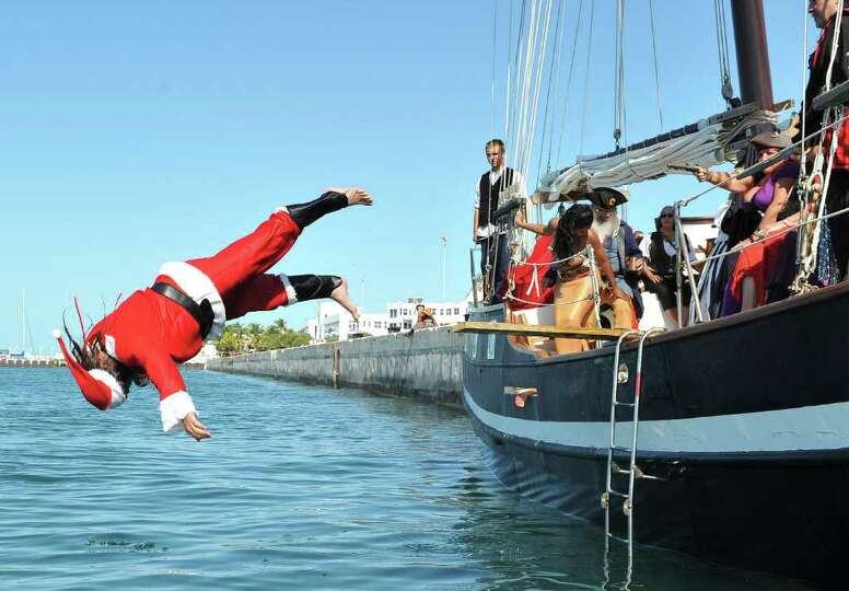 Klaus Chroszielewski, dressed as Santa Claus, competes in the National Walk the Plank contest Saturd