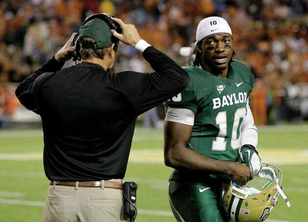 Baylor quarterback Robert Griffin III (10) talks to head coach Art Briles on the sideline in the second half of an NCAA college football game against Texas, Saturday, Dec. 3, 2011, in Waco. Baylor won 48-24. Photo: Tony Gutierrez, Associated Press
