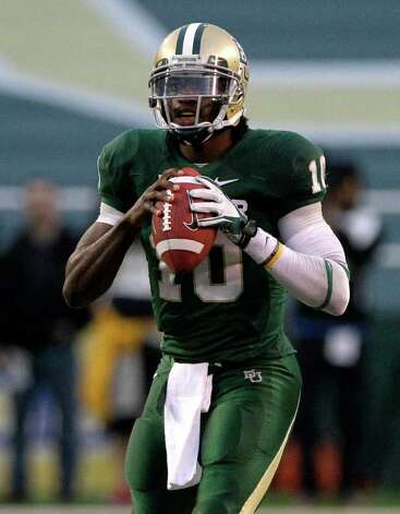 Baylor quarterback Robert Griffin III prepares to pass in the second half of an NCAA college football game against Texas Saturday, Dec. 3, 2011, in Waco. Griffin III ran for two touchdowns and passed for two more to lead No. 19 Baylor to a 48-24 win over Texas. Photo: Tony Gutierrez, Associated Press