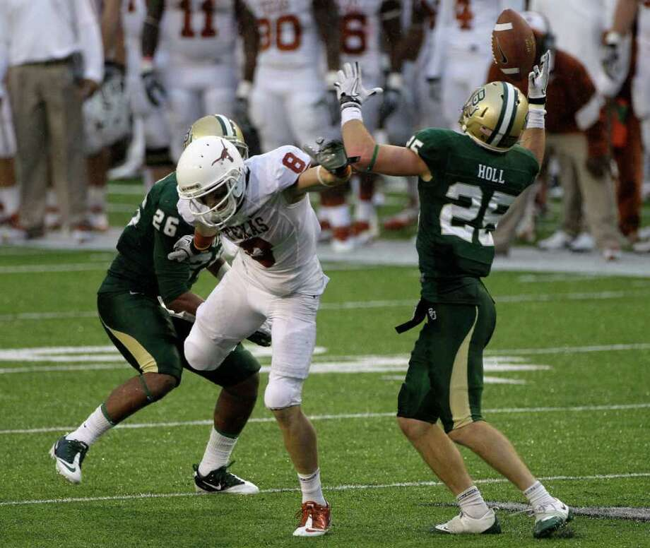 Baylor safety Sam Holl (25) reaches up to intercept a pass intended for Texas wide receiver Jaxon Shipley (8) as linebacker Rodney Chadwick (26) looks on  in the second half of an NCAA college football game Saturday, Dec. 3, 2011, in Waco. Holl had two interceptions in the 48-24 Baylor win. Photo: Tony Gutierrez, Associated Press