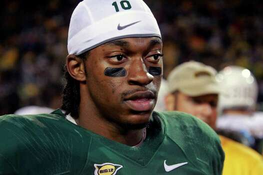 Robert Griffin III fields media questions after the game as Baylor hosts Texas at Floyd Casey Stadium in Waco on  Saturday, Dec. 3, 2011. Photo: TOM REEL, SAN ANTONIO EXPRESS-NEWS  / © 2011 San Antonio Express-News