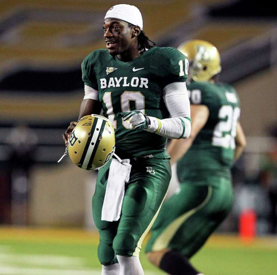 Robert Griffin III enters the game for the final series of downs for the Bears as Baylor hosts Texas at Floyd Casey Stadium in Waco on  Saturday, Dec. 3, 2011. Photo: TOM REEL, SAN ANTONIO EXPRESS-NEWS  / © 2011 San Antonio Express-News