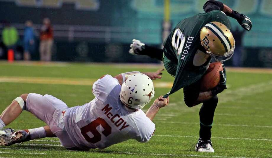Case McCoy is forced to hand tackle Ahmad Dixon who had receovered a Longhorn fumble near the goal line to stop a late threat by Texas as Baylor hosts Texas at Floyd Casey Stadium in Waco on Saturday, Dec. 3, 2011. Photo: TOM REEL, SAN ANTONIO EXPRESS-NEWS  / © 2011 San Antonio Express-News