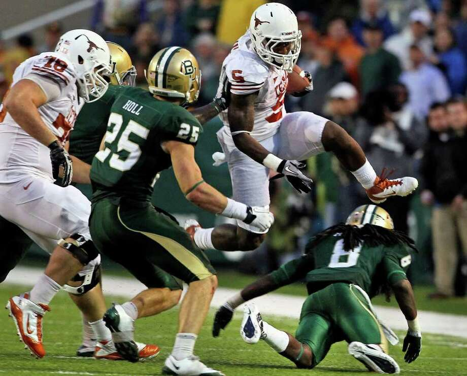 Jeremy Hills takes the high route over some tacklers in the fourth quarter as Baylor hosts Texas at Floyd Casey Stadium in Waco on Saturday, Dec. 3, 2011. Photo: TOM REEL, SAN ANTONIO EXPRESS-NEWS  / © 2011 San Antonio Express-News