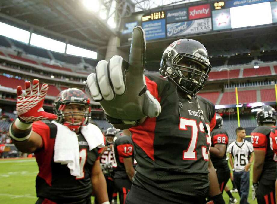 Port Arthur Memorial's Davonte McMillian left, and Jeffery Reno hold their hands in the air after Port Arthur defeated La Porte during the District 21-5A Regional Finals high school football playoff game at Reliant Stadium Saturday, Dec. 3, 2011, in Houston. Photo: James Nielsen, Houston Chronicle / © 2011 Houston Chronicle