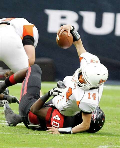 La Porte's quarterback Josh Vidales #14 is tackled by Port Arthur  Jekeil Tyler Memorial's during th
