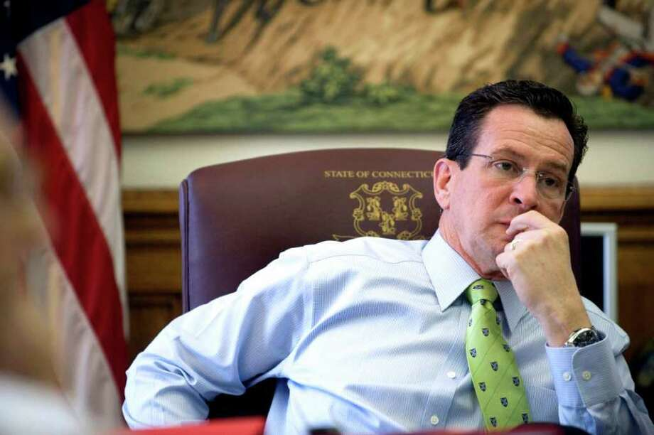 Gov. Dan Malloy in his office at the state Capitol in Hartford, Conn. on his 100th day in office on Thursday April 15, 2011. Photo: Kathleen O'Rourke / Stamford Advocate