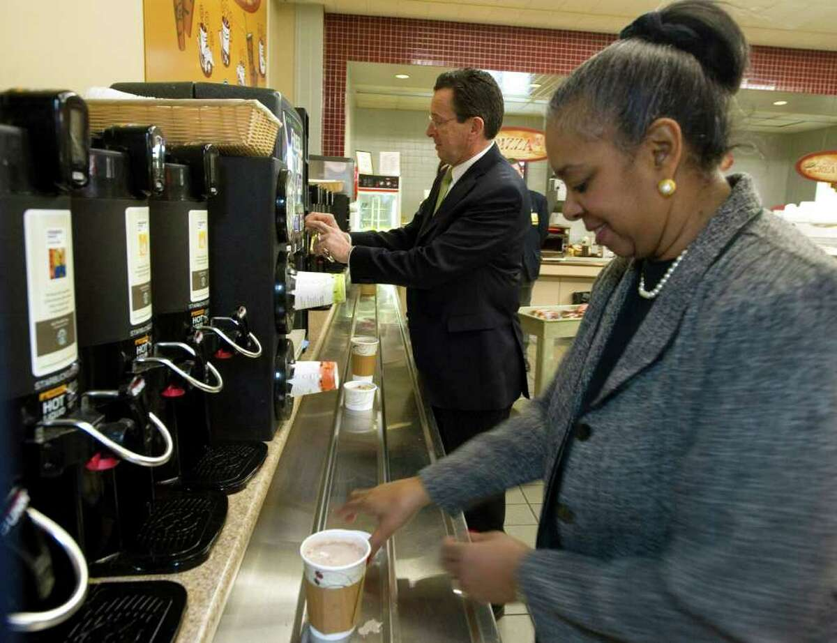 Gov. Dan Malloy grabs a coffee at the cafeteria in the Legislative Office Building in the morning before presenting his budget address to a joint session of the General Assembly in Hartford, Conn. on Wednesday, Feb. 16, 2011.