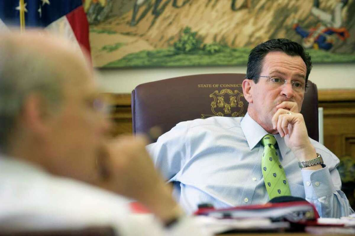 Gov. Dan Malloy in his office with Tim Bannon at the state Capitol in Hartford, Conn. on Thursday April 15, 2011.