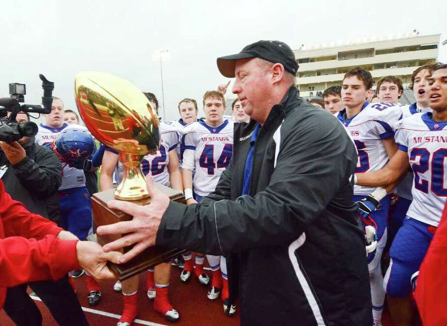Midland Christian coach Greg McClendon accepts the TAPPS Division II State Championship trophy after his team defeated Concordia Lutheran 35-23 Saturday at Leo Buckley Stadium, Killeen. Cindeka Nealy/Reporter-Telegram Photo: Cindeka Nealy, Midland Reporter-Telegram / Cindeka Nealy/Reporter-Telegram