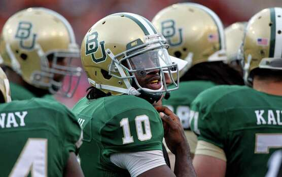 Bears quarterback Robert Griffin III looks to the sideline for instructions as Baylor hosts Texas at Floyd Casey Stadium in Waco on Saturday, Dec. 3, 2011. Photo: TOM REEL, SAN ANTONIO EXPRESS-NEWS  / © 2011 San Antonio Express-News