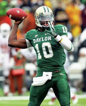 Bears quarterback Robert Griffin III throws as Baylor hosts Texas at Floyd Casey Stadium in Waco on Saturday, Dec. 3, 2011. Photo: TOM REEL, SAN ANTONIO EXPRESS-NEWS / © 2011 San Antonio Express-News