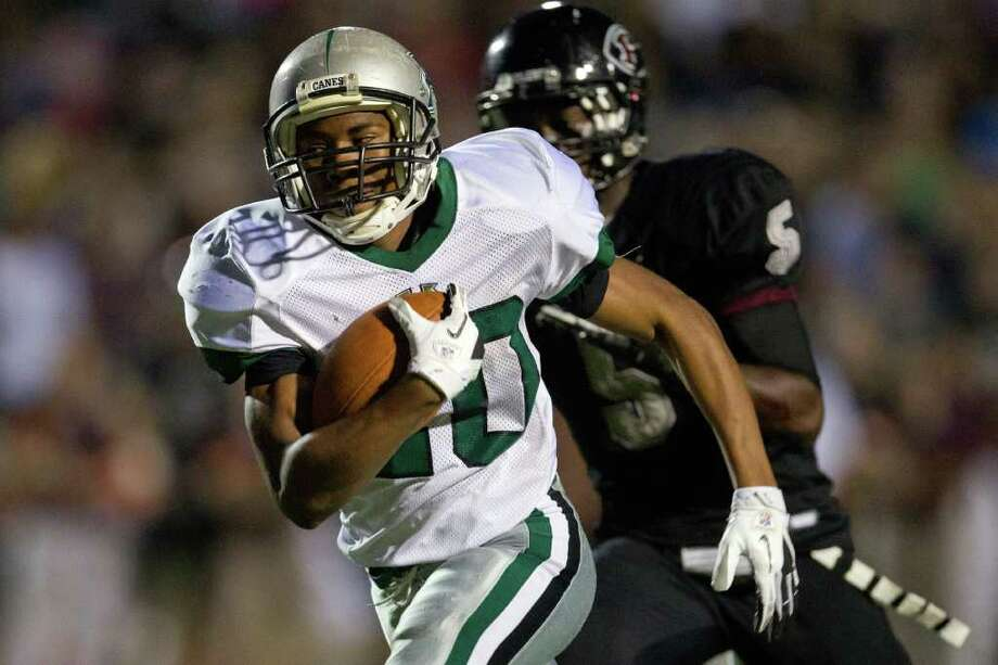 Hightower running back Clone Kinsey (20) races past Pearland defensive back Dyquan Roberts Photo: Smiley N. Pool, Houston Chronicle / © 2011  Houston Chronicle