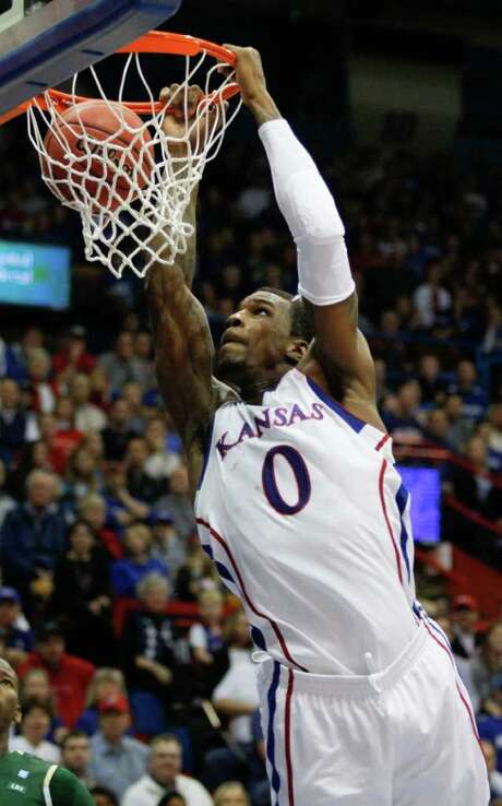 Thomas Robinson, dunking during the first half, and Kansas led by just three at halftime. Photo: AP