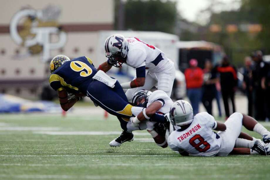 LaMarque wide receiver Kendall Hill (9) is tripped up after a first down catch, during the first half of the Class 4A Division II Region III Championship between the La Marque High School Cougars and the Manvel High School Mavericks, Saturday, December 3, 2011 at Galena Park ISD Stadium in Houston, Texas. Manvel leads at the half, 31-14. Photo: TODD SPOTH, For The Chronicle / Todd Spoth