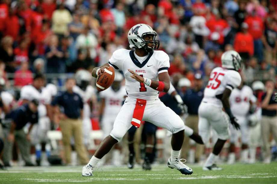 Manvel quarterback Julian Walker (1) prepares to pass during the second half of the Class 4A Division II Region III Championship between the La Marque High School Cougars and the Manvel High School Mavericks, Saturday, December 3, 2011 at Galena Park ISD Stadium in Houston, Texas. Manvel won 38-35. Photo: TODD SPOTH, For The Chronicle / Todd Spoth