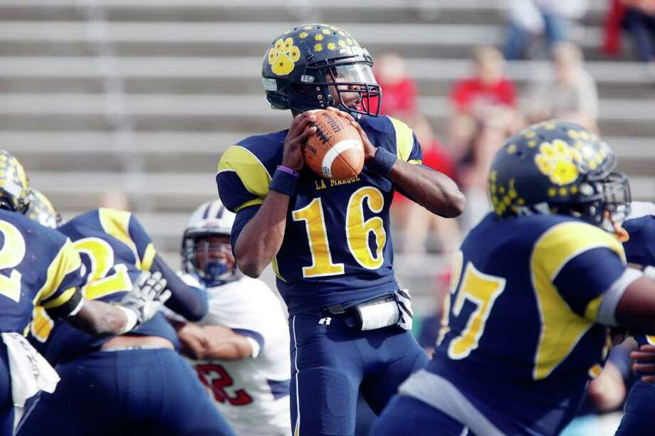 LaMarque quarterback Emanuell Williams (16) drops back to pass during the first half of the Class 4A Division II Region III Championship between the La Marque High School Cougars and the Manvel High School Mavericks, Saturday, December 3, 2011 at Galena Park ISD Stadium in Houston, Texas. Manvel leads at the half, 31-14. Photo: TODD SPOTH, For The Chronicle / Todd Spoth