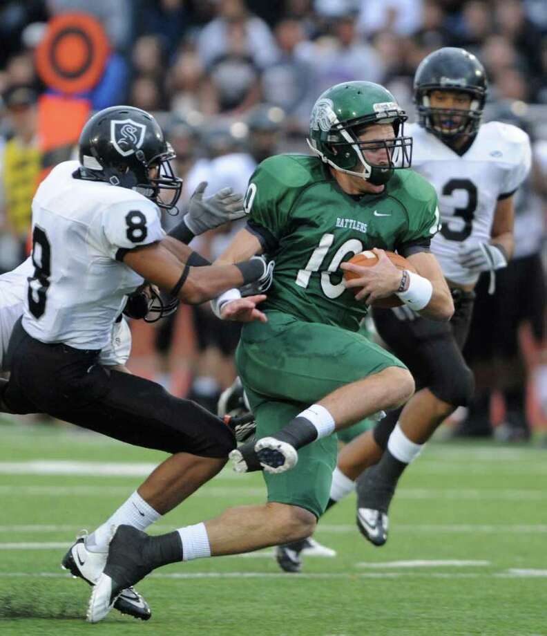 Reagan quarterback Trevor Knight is tackled by Steele defensive back John Burton after a first-half gain in Class 5A Division II state quarterfinals action at Heroes Stadium on Saturday, Dec. 3, 2011. Photo: BILLY CALZADA, SAN ANTONIO EXPRESS-NEWS  / gcalzada@express-news.net